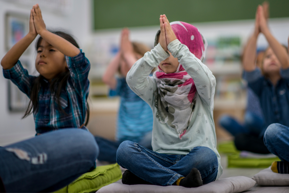 Students practicing brain-based breathing and mindfulness in class